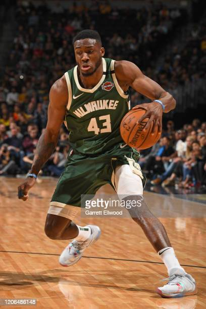 Thanasis Antetokounmpo of the Milwaukee Bucks handles the ball during the game against the Denver Nuggets on March 09 2020 at the Pepsi Center in...