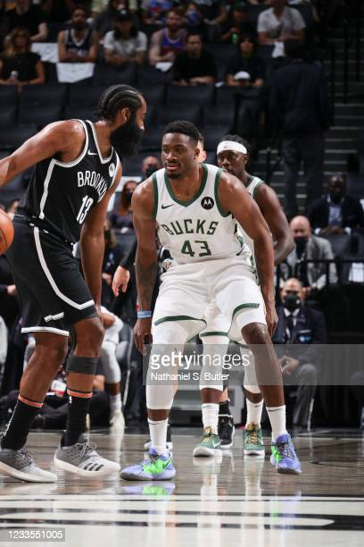 Thanasis Antetokounmpo of the Milwaukee Bucks plays defense as James Harden of the Brooklyn Nets handles the ball during the game during Round 2,...