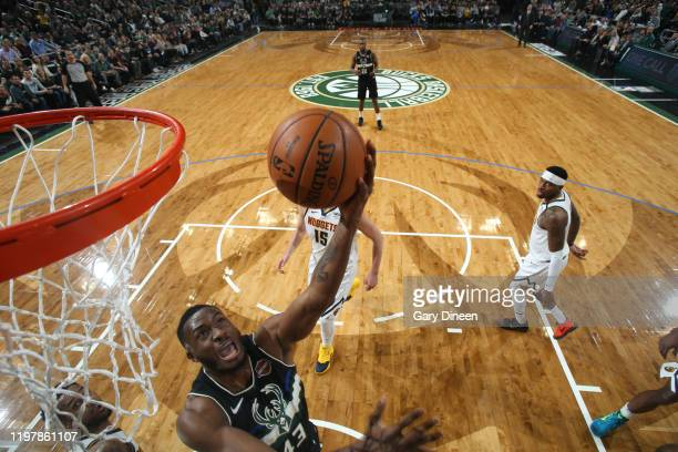 Thanasis Antetokounmpo of the Milwaukee Bucks shoots the ball against the Denver Nuggets on January 31 2020 at the Fiserv Forum Center in Milwaukee...