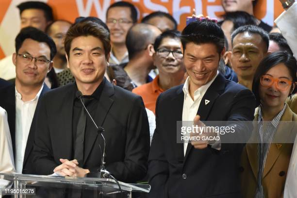 Thanathorn Juangroongruangkit leader of the opposition Future Forward party gestures with the party's secretarygeneral Piyabutr Saengkanokkul at the...