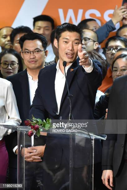 Thanathorn Juangroongruangkit leader of the opposition Future Forward party gestures as he speaks at the party's headquarters in Bangkok on January...