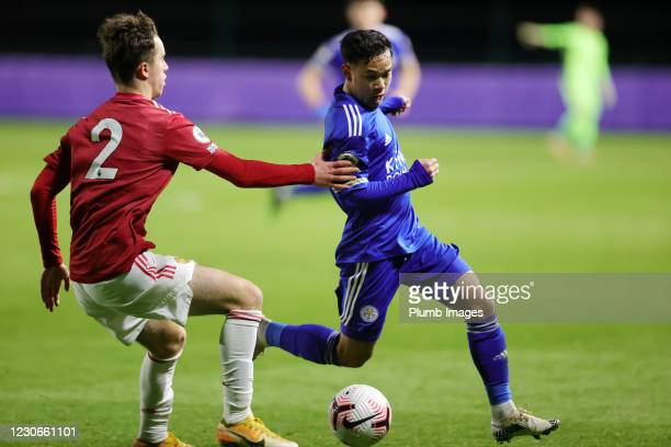 Thanawat Suengchitthawon of Leicester City in action with Harvey Neville of Manchester United during the Premier League 2 match between Leicester...
