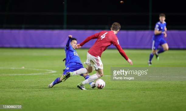 Thanawat Suengchitthawon of Leicester City in action with Will Fish of Manchester United during the Premier League 2 match between Leicester City and...