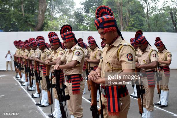 Thane policemen pay homage to police martyrs during a parade on the occasion of National Police Commemoration Day at Thane Rural Police office on...