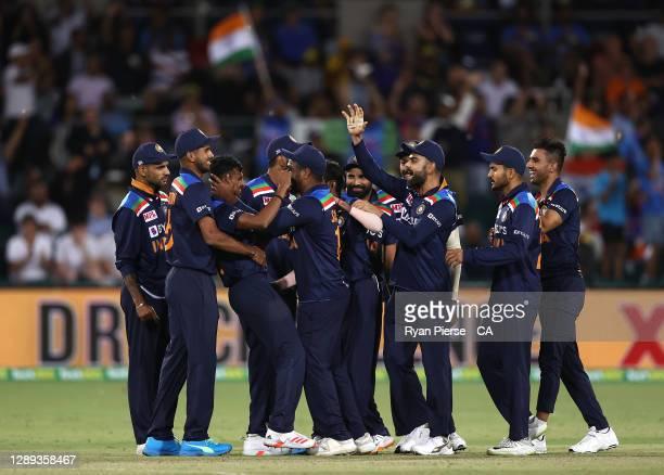 Thangarasu Natarajan of India celebrates after taking the wicket of Glenn Maxwell of Australia during game one of the Twenty20 International series...