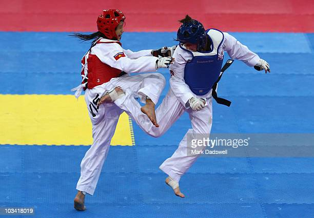 Thanh Thao Nguyen of Vietnam competes with Jade Jones of Great Britain in the Womens 55kg Taekwondo gold medal match on day three of the Singapore...
