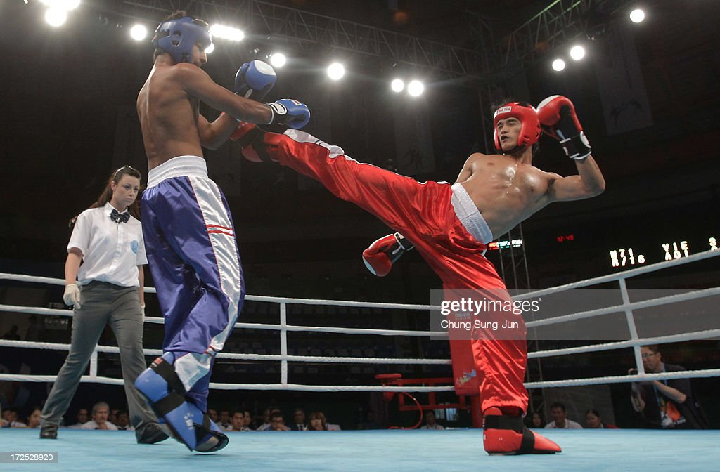Thanh Tran (Red) of Vietnam compete with Kumar Visal (Blue) of India in the Kickboxing, Full Contact Men's 71kg Round of 16 at Dowon Gymnasium during day five of the 4th Asian Indoor Martial Arts Games on July 3, 2013 in Incheon, South Korea.