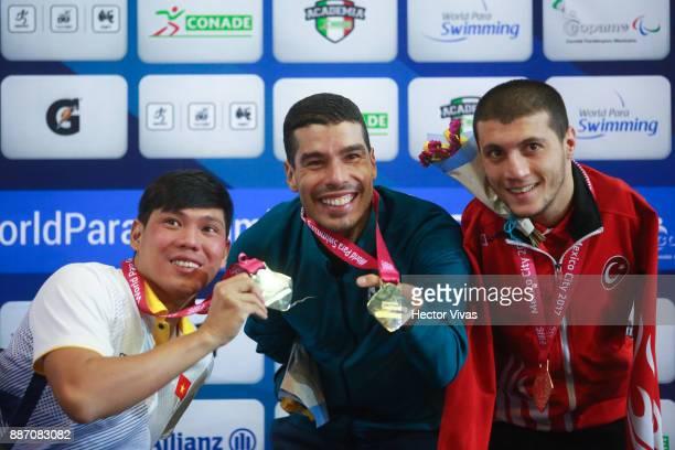 Thanh Tung Vo of Vietnam silver medal Daniel Dias of Brazil gold medal and Beytullah Eroglu of Turkey bronze medal in Men's 50 m Backstroke S5 pose...