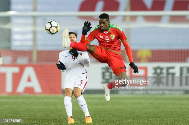 Thani Al Rushaidi of Oman in action against Meshaal AlShammeri of Qatar during the AFC U23 Championship China 2018 Group A match between Oman and...