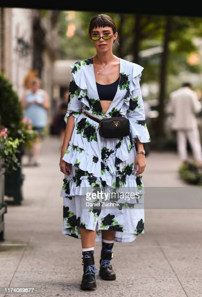 Thania Peck is seen wearing a blue floral dress and Prada bag outside the Marc Jacobs show during New York Fashion Week S/S20 on September 11, 2019...