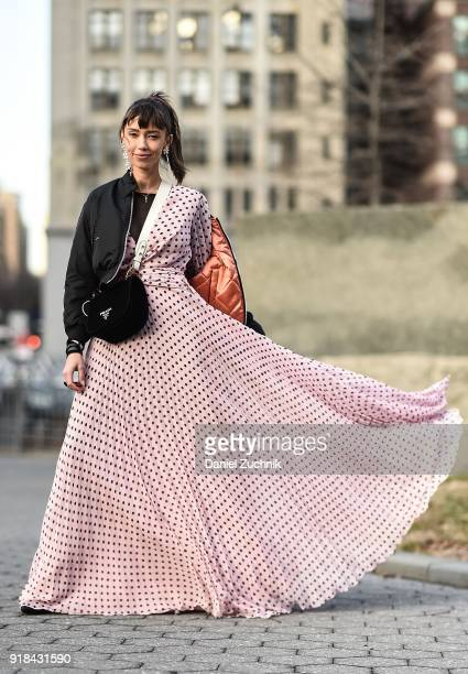 Thania Peck is seen wearing a Sachin and Babi dress Maje bomber Prada bag and Raye shoes outside the Marcel Ostertag show during New York Fashion...