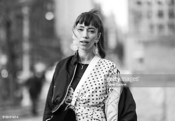 Thania Peck is seen wearing a Sachin and Babi dress Maje bomber with a Prada bag outside the Marcel Ostertag show during New York Fashion Week...