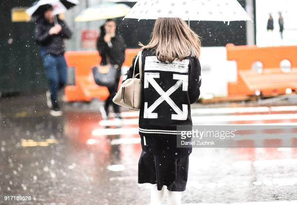 Thania Peck is seen wearing an Off White jacket Coss dress and Senreve bag outside the Tibi show during New York Fashion Week Women's A/W 2018 on...