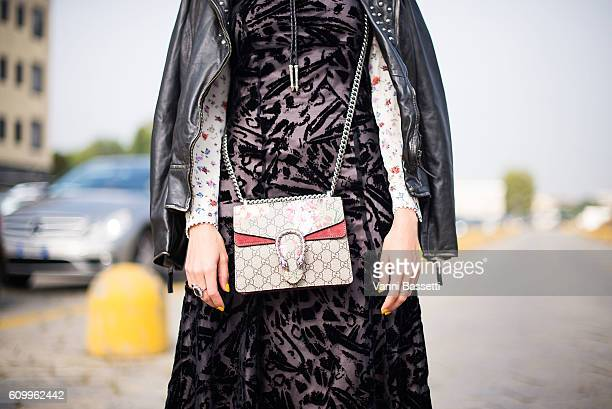 Thania Peck poses with a Gucci bag after the Diesel Black Gold show during Milan Fashion Week Spring/Summer 2017 on September 23 2016 in Milan Italy