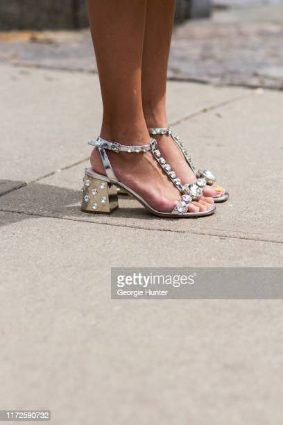 Thania Peck wearing Miu Miu mirrored metallic silver shoes with studded gems on September 05 2019 in New York City