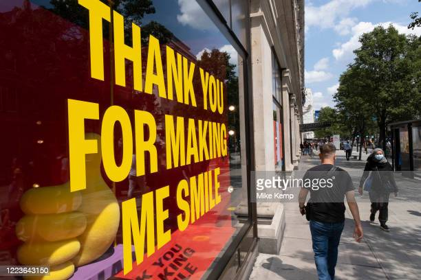 Thank you for making me smile sign in the window of Selfridges as some non-essential shops re-open, shoppers return to Oxford Street while social...