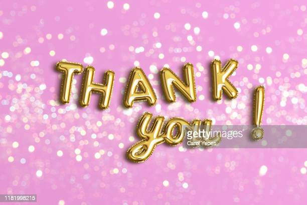 thank you in golden foil ballon.pink background - thank you stock pictures, royalty-free photos & images
