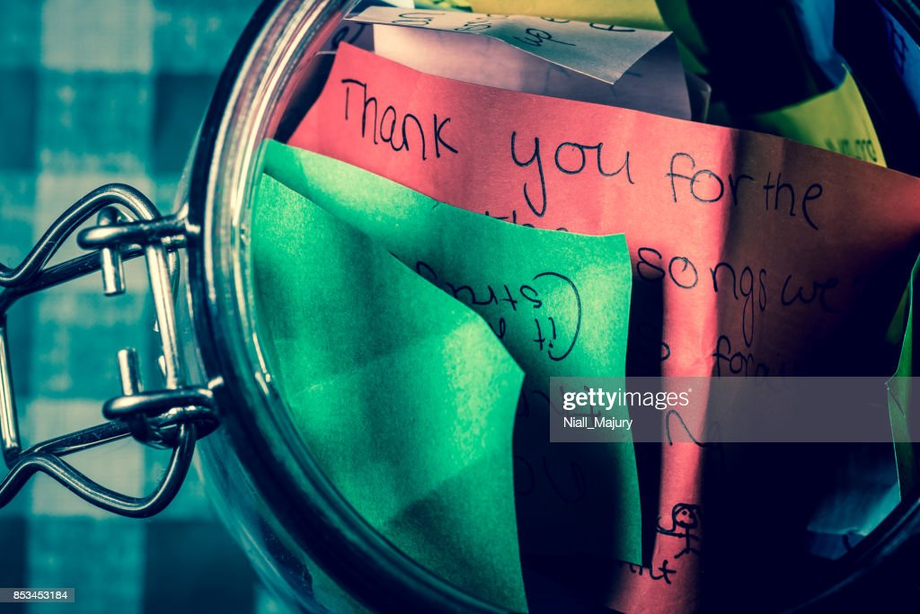 Thank you jar with messages written on coloured paper : Stock Photo