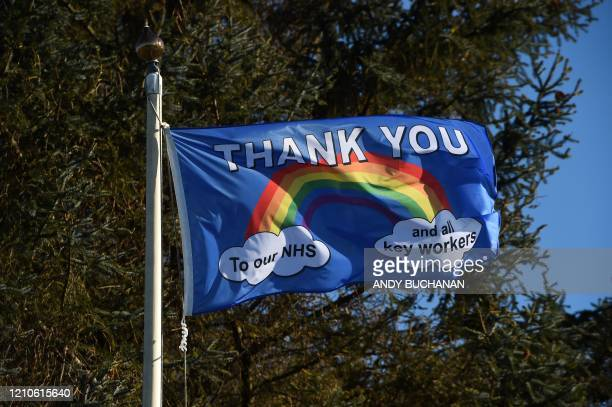 Thank you NHS flutters at the golfcourse in Grangemouth, Scotland, on April 21, 2020. - Oil-price turmoil gripped traders once more Tuesday, a day...