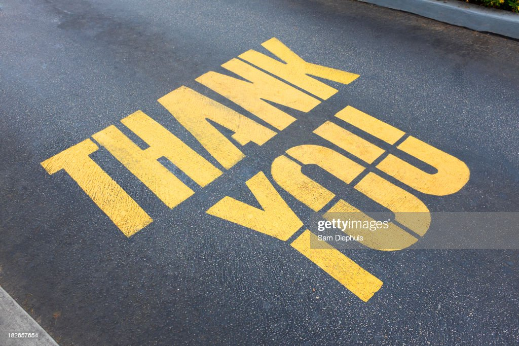 'Thank you' painted on concrete : Stock Photo