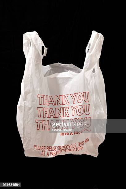 """""""thank you"""" plastic shopping bag - thank you stock pictures, royalty-free photos & images"""