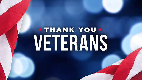Thank You Veterans Text with American Flag Over Blue Lights Background for Memorial Day and Veterans Day Holidays 1222079337