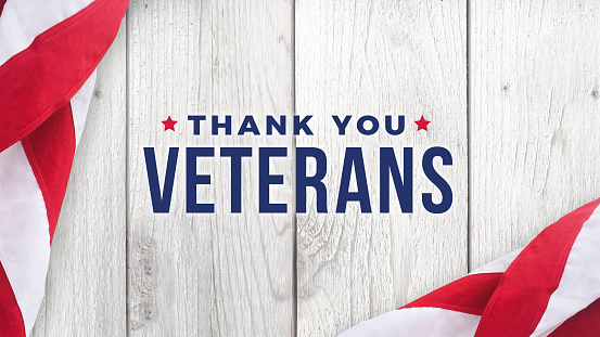 Thank You Veterans Text with American Flags Over Wood Background 920183718
