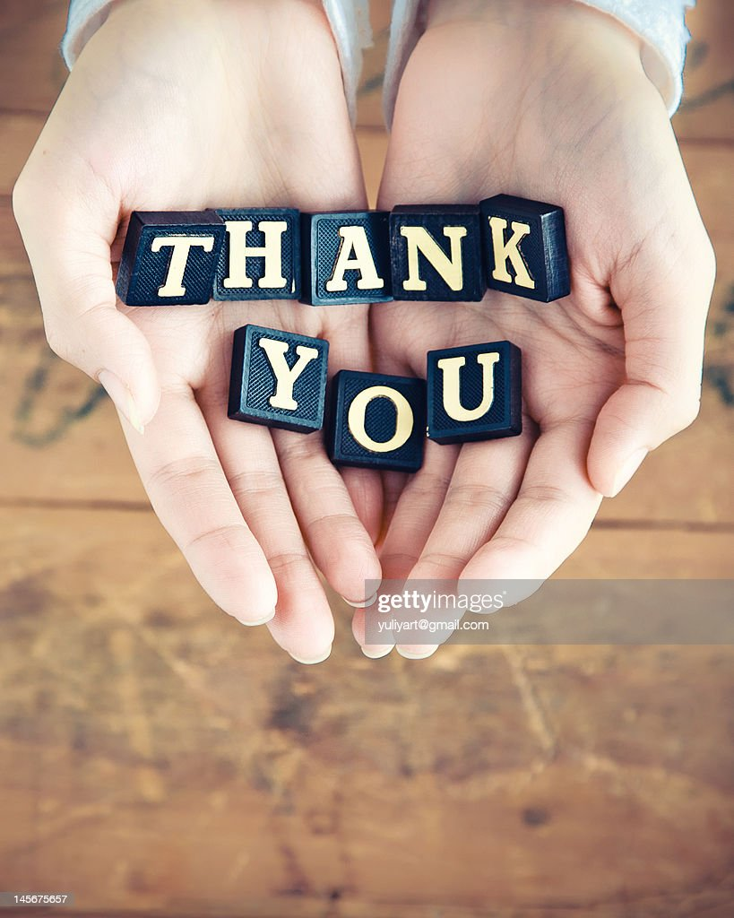 Thank you written in hands : Stock Photo