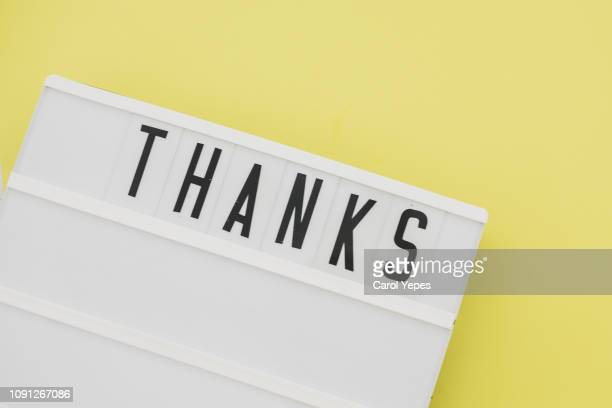 thanks message in lightbox.yellow background - gratitude stock pictures, royalty-free photos & images