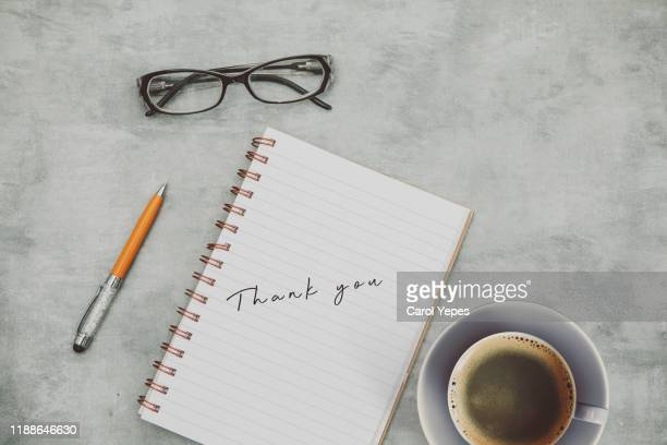 thanks message in open noteboook - thank you stock pictures, royalty-free photos & images