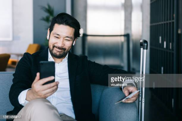 thanks to technology i can stay connected anywhere in the world. - 40 44 years stock pictures, royalty-free photos & images