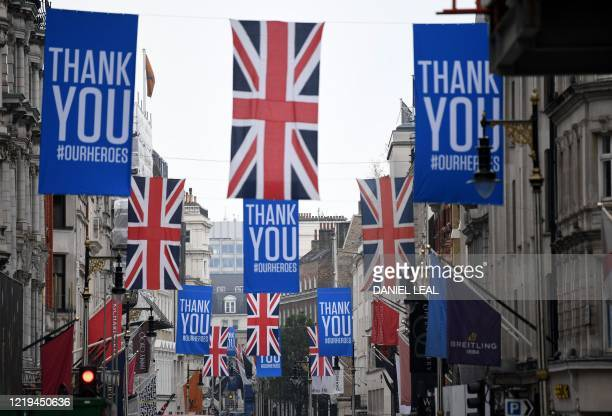 Thanks you flags hang alongside Union flags above New Bond Street in London on June 12 as non essential retailers made to close due to the COVID19...