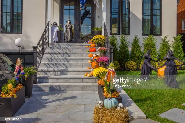 thanksgiving and halloween decoration in front of a house in brooklyn, new york, usa. - garden decoration stock pictures, royalty-free photos & images