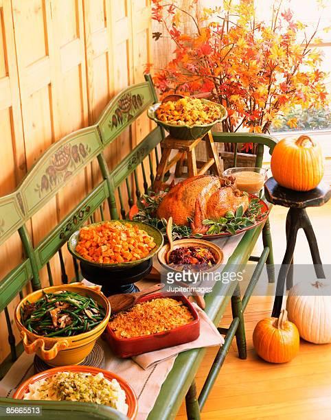 Thanksgiving buffet on a bench