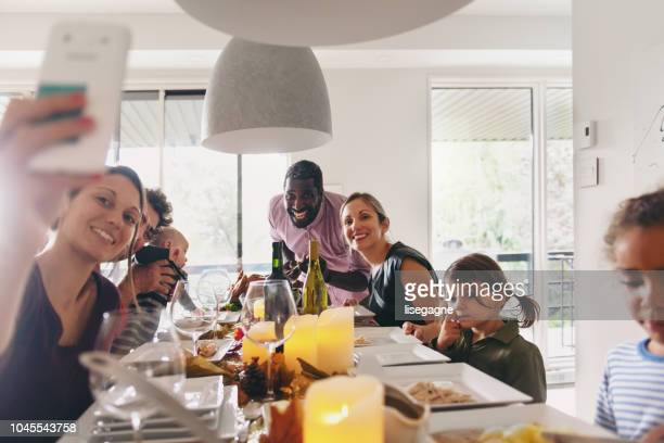 thanksgiving celebration with friends - canadian thanksgiving stock pictures, royalty-free photos & images
