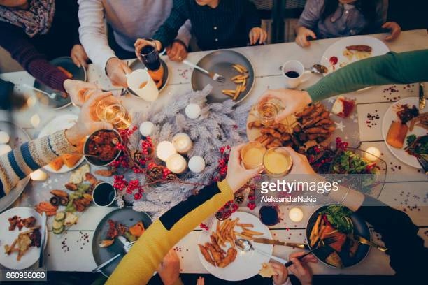 thanksgiving celebratory toast - thanksgiving table stock photos and pictures