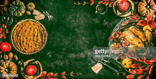 thanksgiving day background with roasted whole chicken or little turkey and pumpkin pie on dinner table with festive decoration - happy thanksgiving banner stock pictures, royalty-free photos & images
