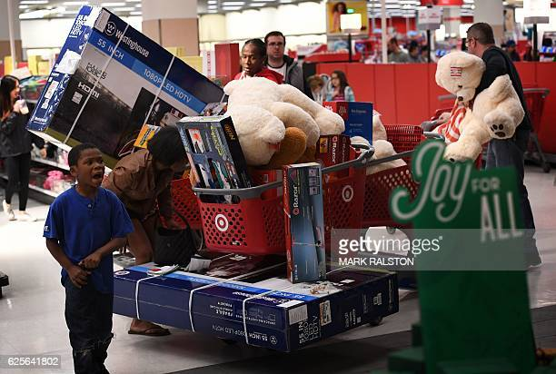 Thanksgiving Day shoppers push loaded up carts during the 'Black Friday' sales at a Target store in Culver City California on November 24 2016 US...