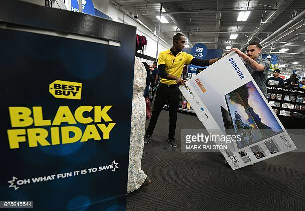 Thanksgiving Day shoppers wait to check out during the 'Black Friday' sales at a Best Buy store in Culver City California on November 24 2016 US...