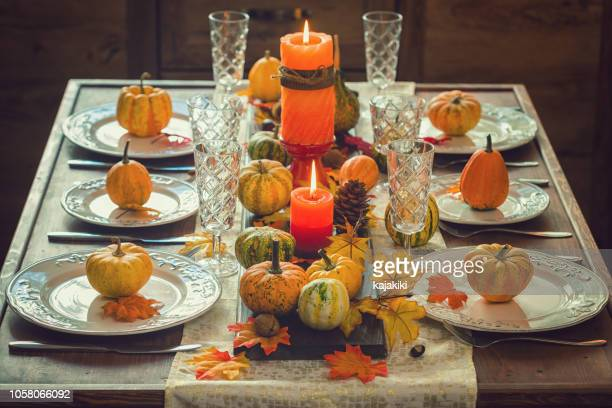 thanksgiving dining table place setting with autumn decoration - thanksgiving background stock photos and pictures