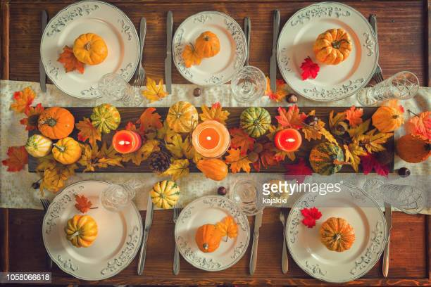 thanksgiving dining table place setting with autumn decoration - old fashioned thanksgiving stock photos and pictures