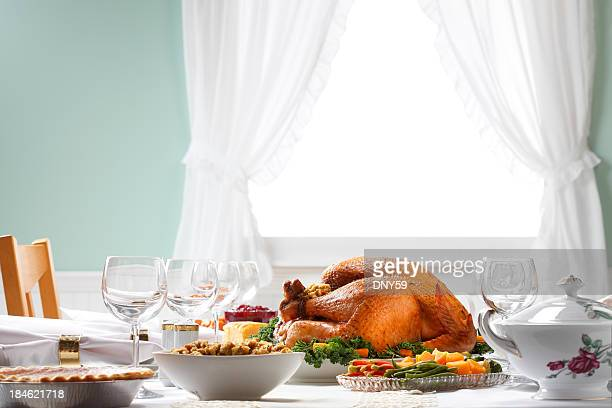 thanksgiving dinner table spread with natural light - thanksgiving holiday stock pictures, royalty-free photos & images