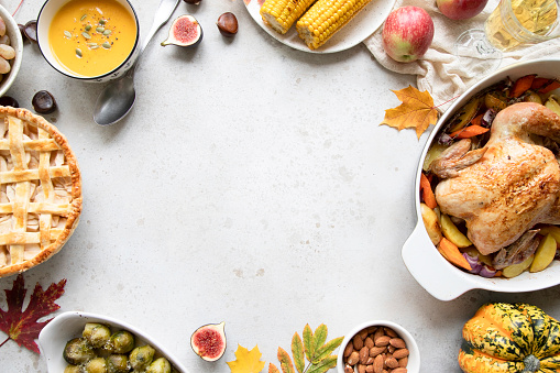 Thanksgiving dinner with chicken, apple pie, pumpkin soup brussel sprouts and fruits. 1060860760