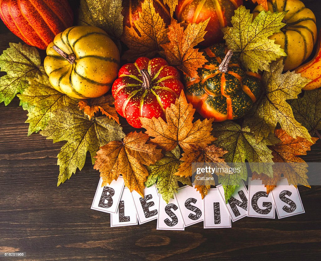 Thanksgiving fall arrangement with pumpkins, leaves and blessings message : Stock Photo