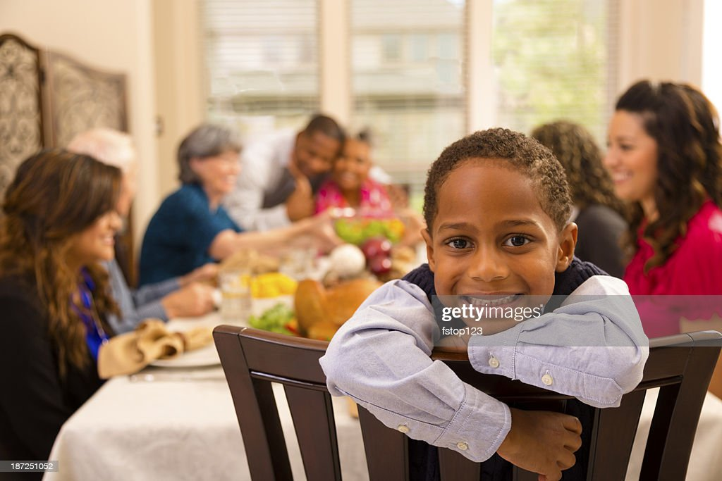 Thanksgiving: Family and friends gather for dinner at grandma's house. : Stock Photo