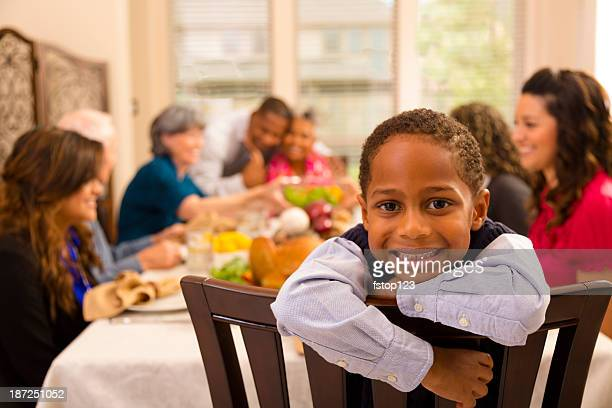 thanksgiving: family and friends gather for dinner at grandma's house. - black family dinner stock photos and pictures