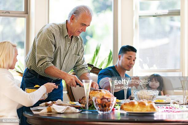 thanksgiving family dinner - stepfamily stock photos and pictures