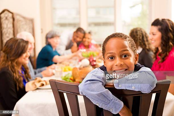 Thanksgiving: Family gathers for dinner at grandma's house. Little boy.