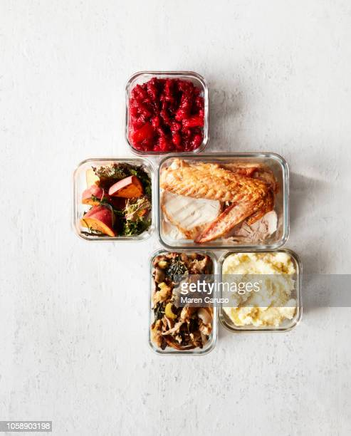 thanksgiving leftovers in containers on white wood - leftovers stock pictures, royalty-free photos & images