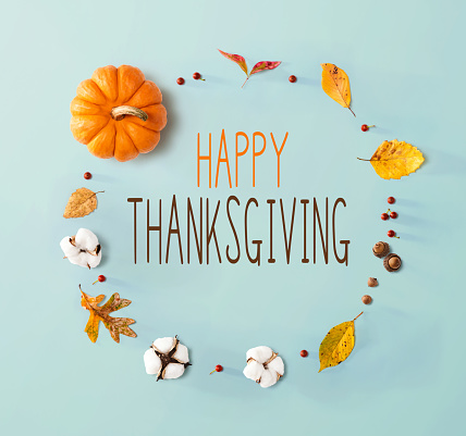 Thanksgiving message with autumn leaves and orange pumpkin 1184421558